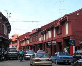Image: Shophouses at Jalan Laksamana have been repainted red from the yellow, blue and purple.