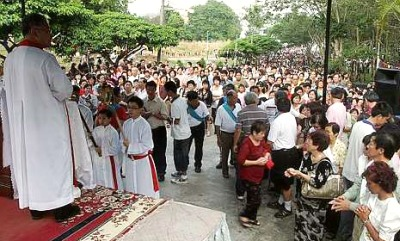 Image: Rev. Fr. Moses Lui presiding over the religious service in front of the chapel.