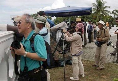 Image: Avid bird watchers at Tanjung Tuan scanning the skies for the migratory birds.
