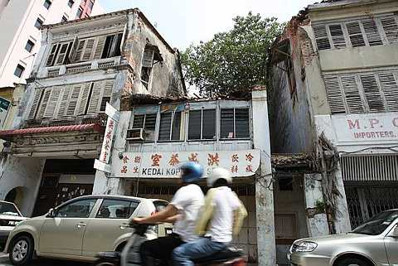 Image: Run-down shophouses on Lebuh Cina stick out like sore thumbs.
