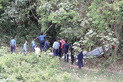 Image: Police personnel inspecting the wreckage of the RMAF Pilatus PC-7 after it crashed behind the Bukit Tangga Malaysian Agricultural Research and Development Institute (Mardi) next to the UUM campus on Thursday.