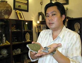 Image: Jason Yoong showing off the celadon shard and tin piece found here over the years that support the 1278 founding year.